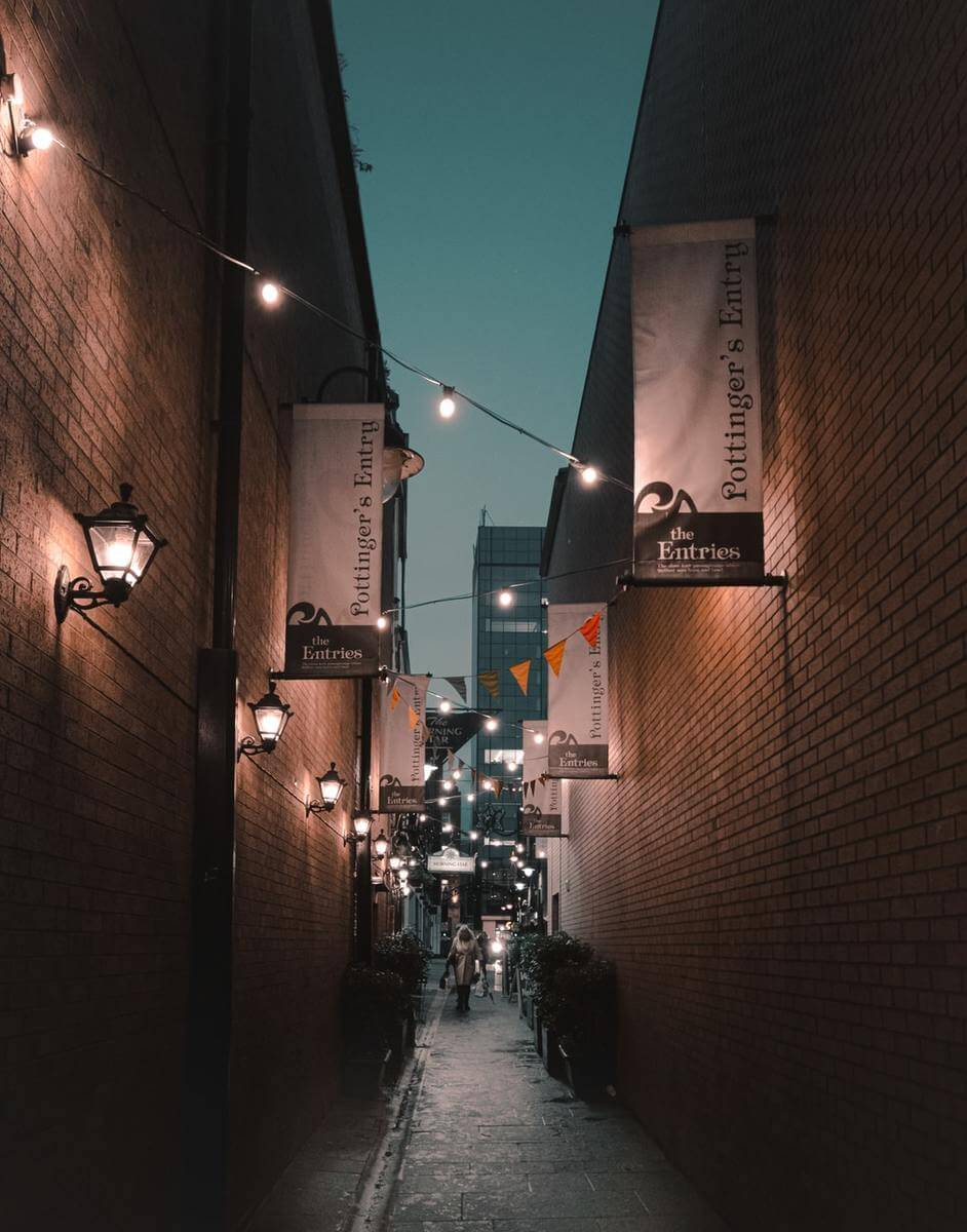 street between buildings with string light